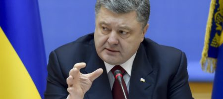 Ukrainian President Petro Poroshenko speaks during a government meeting in Kiev, February 11, 2015. Poroshenko said on Wednesday Ukraine was prepared to introduce martial law across Ukraine if the separatist conflict in the east escalates further, news agency Interfax reported. REUTERS/Mykola Lazarenko/Ukrainian Presidential Press Service/Handout via Reuters (UKRAINE - Tags: POLITICS CIVIL UNREST MILITARY CONFLICT) ATTENTION EDITORS - THIS PICTURE WAS PROVIDED BY A THIRD PARTY. REUTERS IS UNABLE TO INDEPENDENTLY VERIFY THE AUTHENTICITY, CONTENT, LOCATION OR DATE OF THIS IMAGE. FOR EDITORIAL USE ONLY. NOT FOR SALE FOR MARKETING OR ADVERTISING CAMPAIGNS. THIS PICTURE IS DISTRIBUTED EXACTLY AS RECEIVED BY REUTERS, AS A SERVICE TO CLIENTS