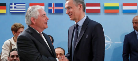 U.S. Secretary of State Rex Tillerson (L) shakes hands with NATO Secretary General Jens Stoltenberg during a NATO foreign ministers meeting at the Alliance's headquarters in Brussels, Belgium March 31, 2017. REUTERS/Yves Herman