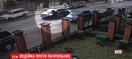 Во Львове неадекватная женщина сбила и протянула на капоте своего копа (ВИДЕО)