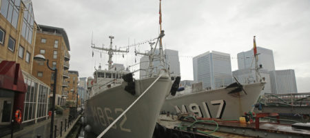Naval ships of various NATO countries are moored in the Canary Wharf business district in London November 22, 2014. NATO warplanes have had to scramble 400 times this year in response to an increase in Russian air activity around Europe not seen since the Cold War, the alliance's chief said on Thursday.  North Atlantic Treaty Organisation members have sought to fill gaps in the alliance's land, air and sea defences since Russia annexed Crimea and backed a secessionist movement in the eastern part of Ukraine.    REUTERS/Luke MacGregor  (BRITAIN - Tags: POLITICS CONFLICT MILITARY MARITIME) - GM1EABM1PWN01